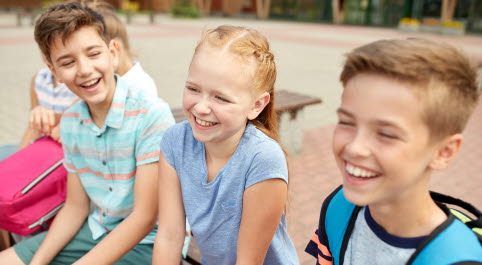 Mostphotos-group-of-happy-elementary-school-students-talking.jpg